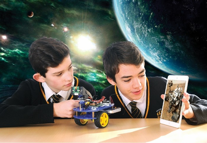 Students Ethan and Finn with the Mars Rover robot