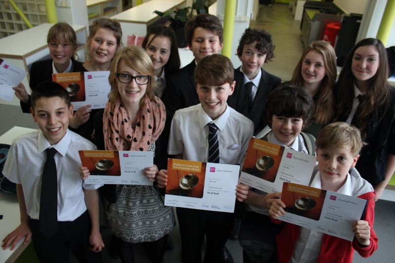 Year 8s pose with their certificates from the Mock Trial