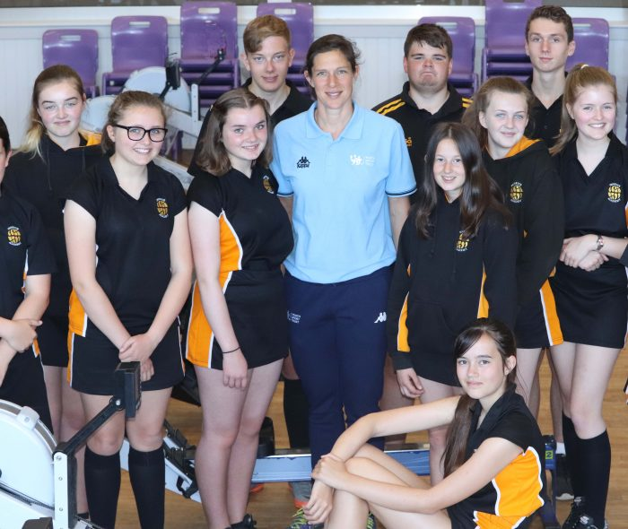 photo graph of Olympian and Rowing Club students